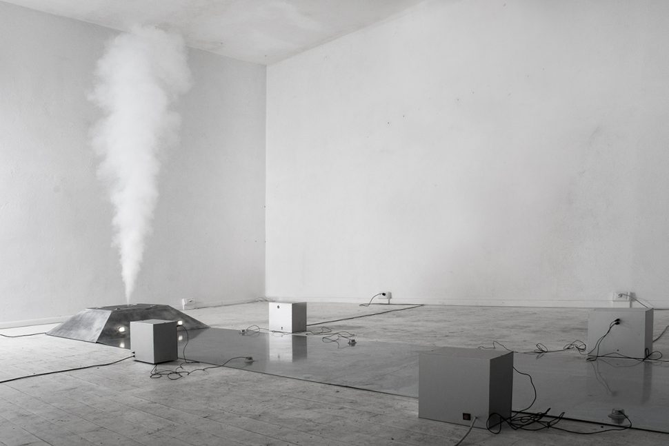 Donato Piccolo, Reversible carpet and irreversible geyser, 2012, Iron, aluminum, steel, smog machine, timer, electronic system, speakers, microphone cox, 12 m x 1,30 m
