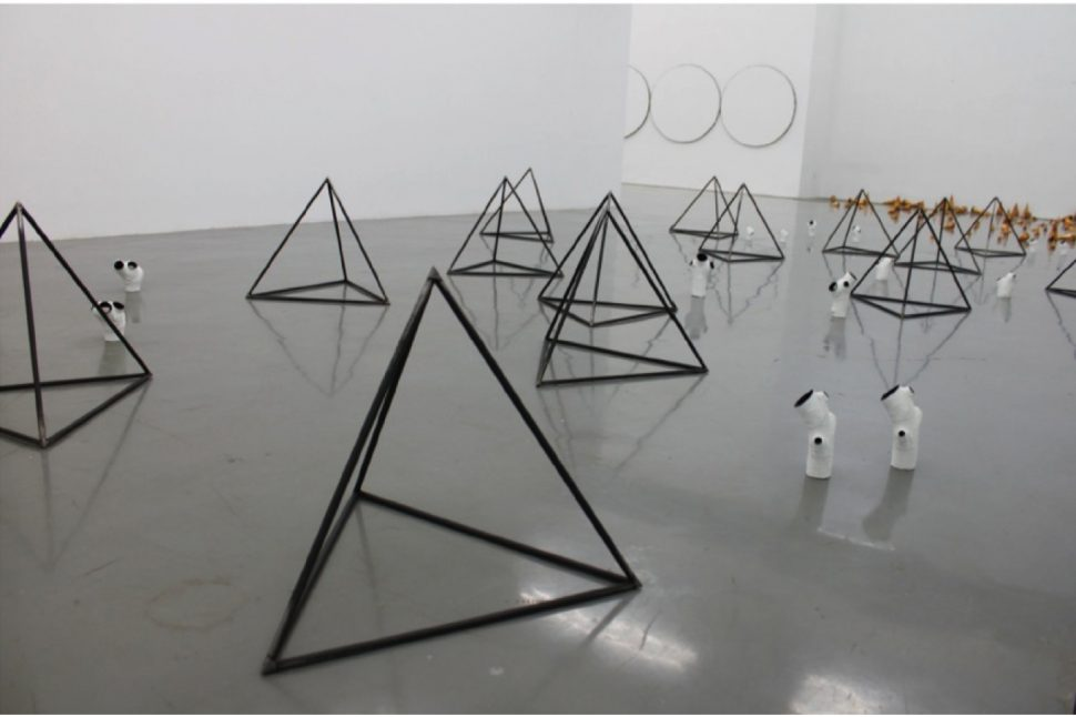 Yang Xinguang, View of installation, Pyramid, 2012, Steel, bronze, oils, 29 pieces, Variable dimensions