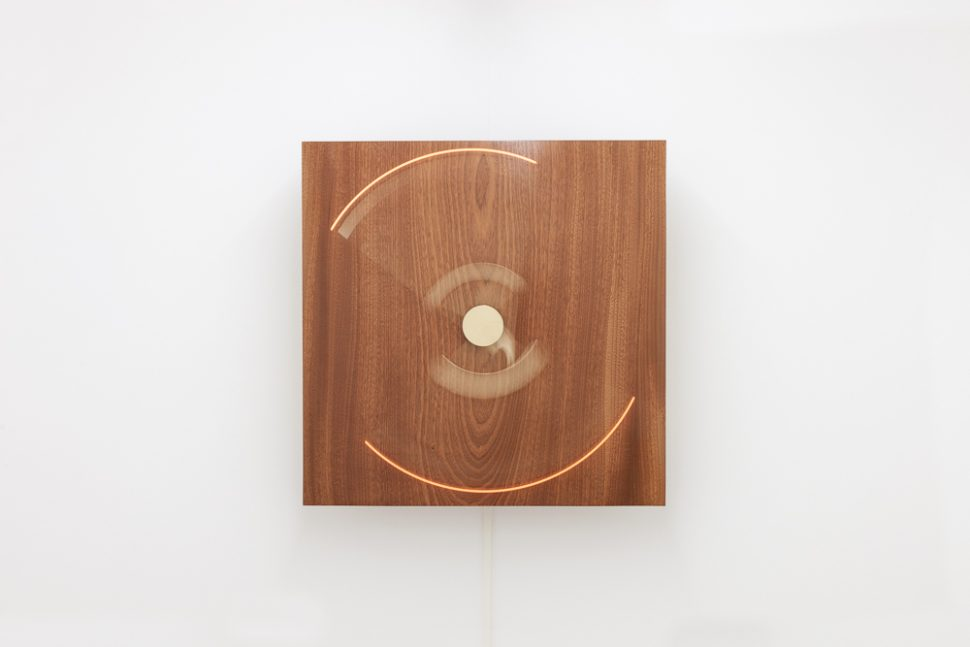 Laurent Bolognini, AM7, 2014, African solid wood varnish, brass, motor, electonic bulbs, 70 x 70 x 26 cm. Exhibition view of