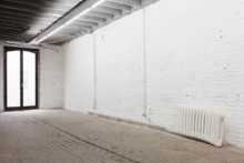 Roeland Tweelinckx, Curved Heating, 2013, Styrofoam, wood, paint and its surroundings, Variable dimensions