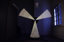Laurent Bolognini, Stella, 2012, bulbs, aluminium, carbon, electric motor and electronic components, 232 x 232 x 20 cm