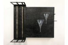 Pieter Laurens Mol, Kroniek der Vergetelheid (Chronicle of Oblivion), 1988, Coaltar on plaster on burlap on blackened steel construction with two glass funnels and three band saws, 91.5 x 107.5 x 33 cm (overall size)