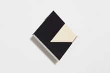 Fernanda Fragateiro, overlap (black and white), 3, 2020, Polished stainless steel and manufactured notebooks with fabric cover, 50 x 50 x 7 cm